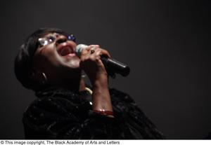Primary view of object titled '[Close Up of Singer on Stage]'.