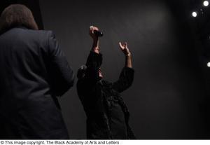Primary view of object titled '[Singer on Stage with Curtis King]'.