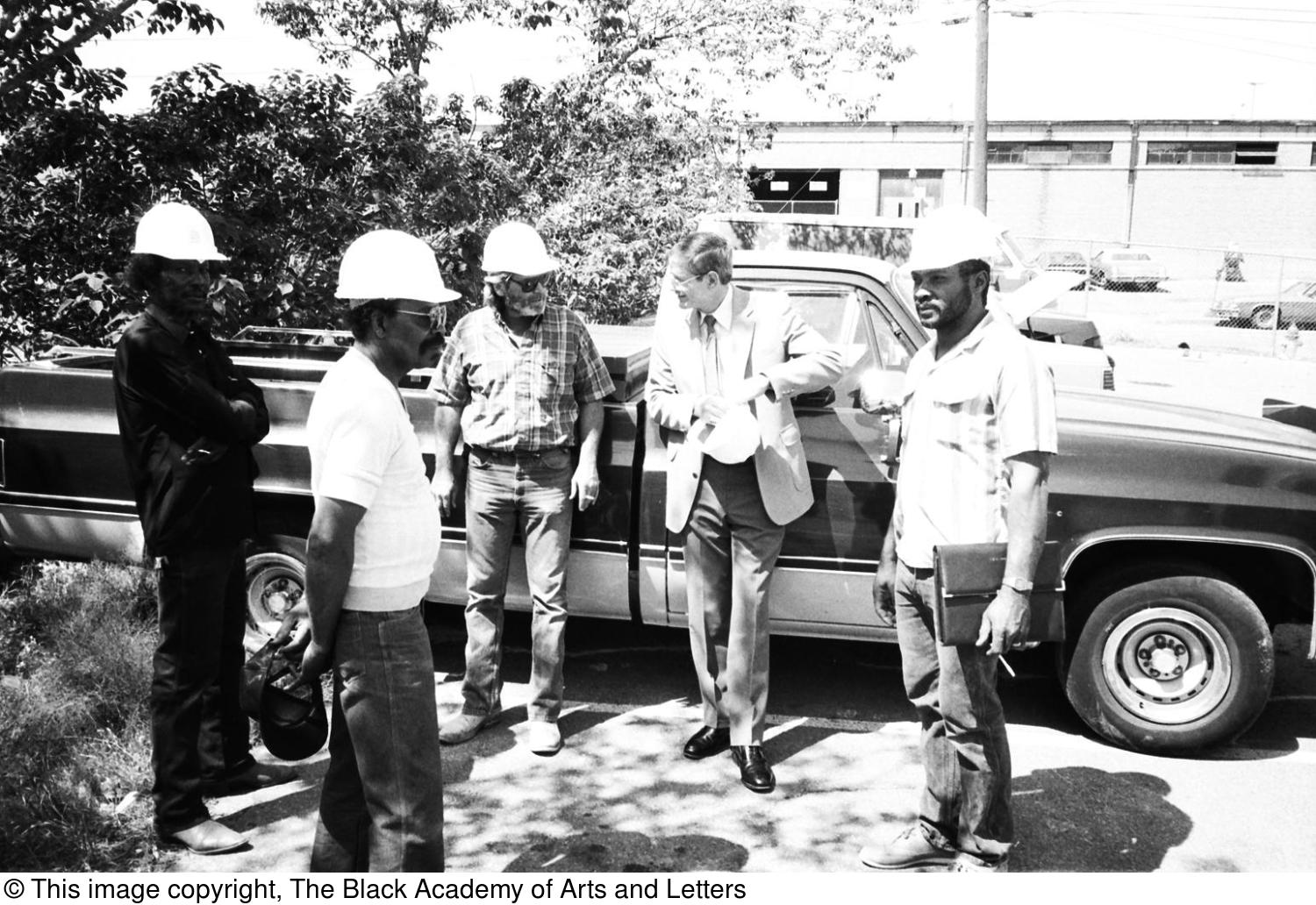 [Unidentified People in Hard Hats Near Pickup]                                                                                                      [Sequence #]: 1 of 1
