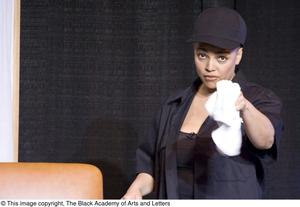 Primary view of object titled '[Kim Fields Pointing at Camera with Towel in Hand]'.