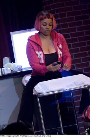 Primary view of object titled '[Kim Fields Sitting on Exam Table with Cell Phone]'.