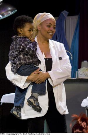 Primary view of object titled '[Kim Fields Holding Son on Stage]'.