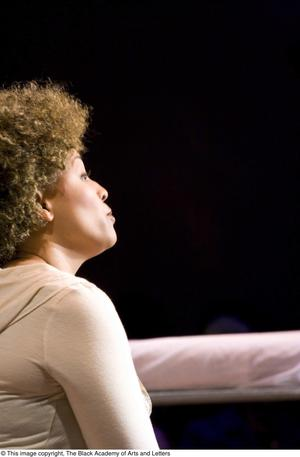 Primary view of object titled '[Side View of Kim Fields on Stage]'.