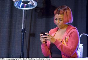 Primary view of object titled '[Kim Fields on Stage with Cell Phone]'.