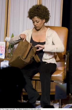 Primary view of object titled '[Kim Fields Looking Through Bag on Stage]'.