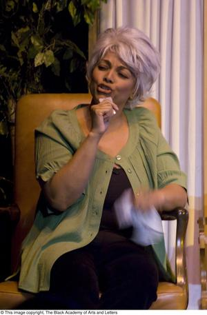 Primary view of object titled '[Kim Fields on Stage in Grey Wig]'.