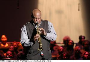 Primary view of object titled '[Man Playing Saxophone on Stage]'.