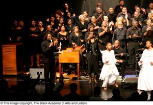 Primary view of object titled '[Curtis King on Stage with Worship Dancers and Choir]'.