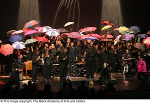 Primary view of object titled '[Large Ensemble on Stage with Umbrellas]'.