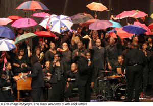 Primary view of object titled '[Solo Singer in Front of Chorus with Umbrellas]'.