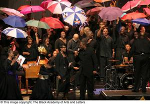 Primary view of object titled '[Solo Singer in Front of Large Ensemble with Umbrellas]'.