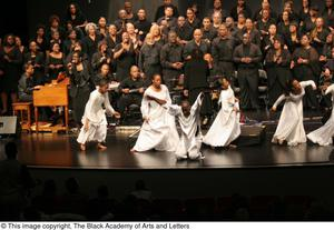 Primary view of object titled '[Dereque Whiturs on Stage with Dance Team and Choir]'.