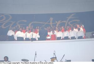 Primary view of object titled '[Chorus on Stage Dressed in Red and White]'.