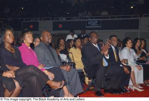 Primary view of [View of Audience Members Sitting and Smiling]