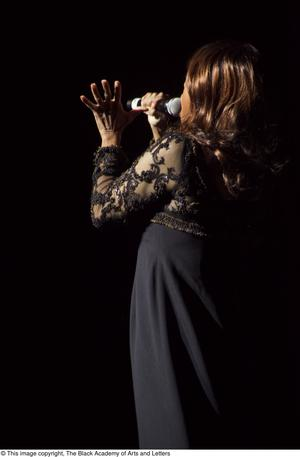 Primary view of object titled '[Jennifer Holliday on Stage Singing]'.