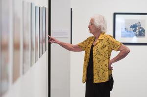 Primary view of object titled '[Joyce Bankston Pointing at Photograph]'.