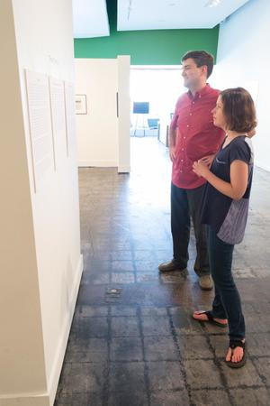Primary view of object titled '[Julie Judkins and Kevin Hawkins, viewing art at the Diane E. Williams Reception]'.