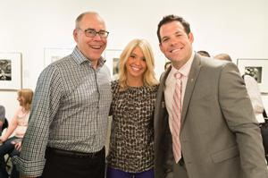 Primary view of object titled '[UNT President Neal Smatresk (left), Amanda Quinn (center) and Johnny Quinn (right)]'.
