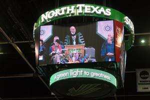 Primary view of object titled '[President Neal Smatresk on the Jumbotron]'.