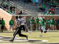 Thumbnail image of item number 1 in: '[Portland State Football Player to Catch Ball]'.