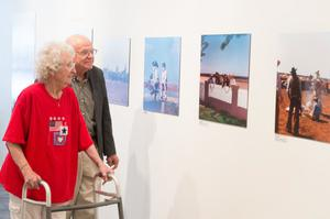 Primary view of object titled '[J. Don and Dolores Vann Enjoying Exhibit Photos]'.