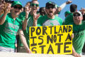 Photograph: [Mean Green Fan Holding up Sign]