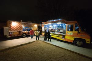 Primary view of object titled '[Food trucks parked behind the Eastside Social Club]'.