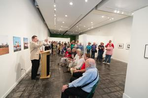 Primary view of object titled '[Martin Halbert Addressing Exhibit Attendees]'.