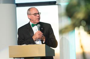 Primary view of object titled '[UNT President Smatresk Speaks into Microphone]'.