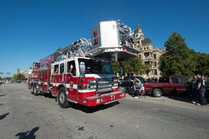 Primary view of object titled '[Firetruck in the 2015 Homecoming parade]'.