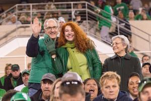 Primary view of object titled '[Dreanna Belden and Cathy Hartman at the 2014 Homecoming Football Game]'.