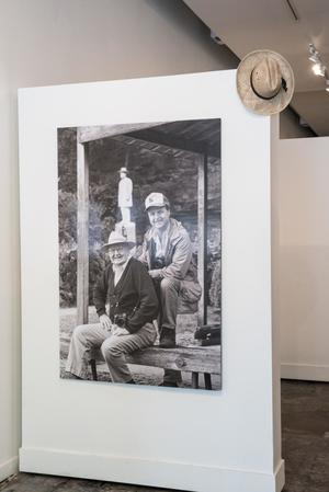 Primary view of object titled '[Photo of Joe and Junebug Clark and a Hat]'.