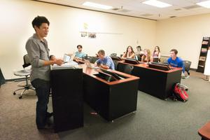 Primary view of object titled '[Visiting lecturer Danny Fulgencio teaching a class]'.