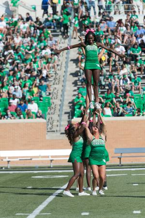 Primary view of object titled '[UNT Cheerleaders Performing Basic Extension]'.