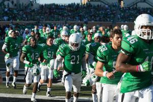 Primary view of object titled '[UNT Football Players Running on Field]'.