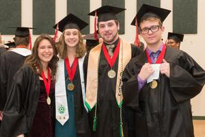 Primary view of object titled '[Students Smile for Photo at the Fall 2014 Undergraduate Commencement Ceremony]'.