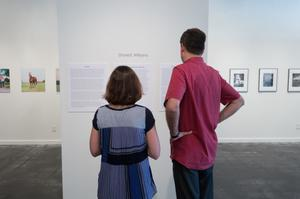 Primary view of object titled '[Couple Looking at Art from the Diane E. Williams Art Reception]'.