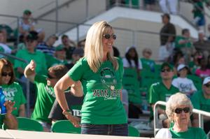 Primary view of object titled '[UNT Mean Green Fan in Stands]'.