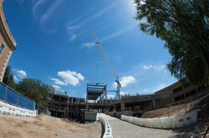 Primary view of object titled '[Steel beam hoisted onto the UNT University Union building]'.