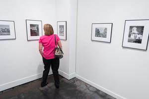 Primary view of object titled '[Woman in Pink at Exhibit]'.