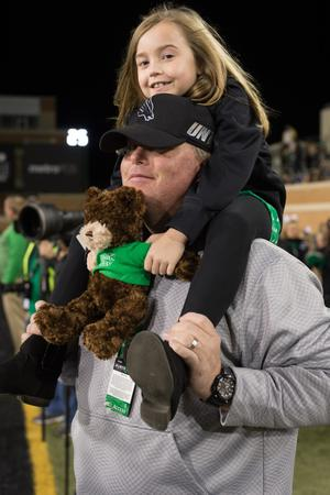 Primary view of object titled '[Father and Daughter at Homecoming game]'.