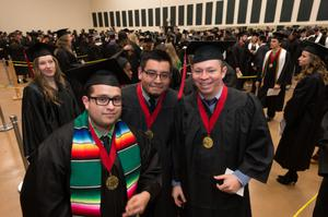 Primary view of object titled '[Mayborn School of Journalism Students Posing for Photo at the Fall 2014 Undergraduate Commencement Ceremony]'.