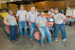 Primary view of object titled '[UNT facilities and maintenance workers pose with tractor]'.