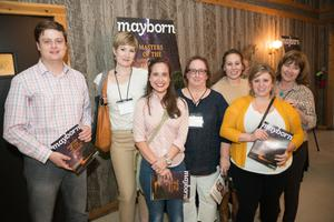 Primary view of object titled '[Conference Attendees Holding Mayborn Magazine]'.