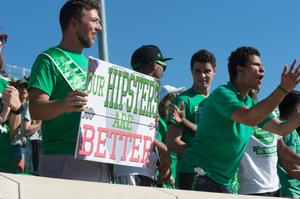 Primary view of object titled '[Mean Green Fan Holding up Sign at Homecoming Game]'.