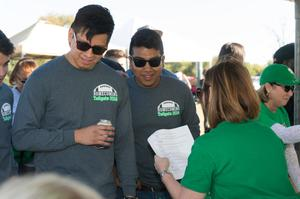 Primary view of object titled '[Students at the 2014 Homecoming Tailgating Event]'.