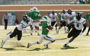 Primary view of object titled '[Portland State Player To Tackle Mean Green]'.