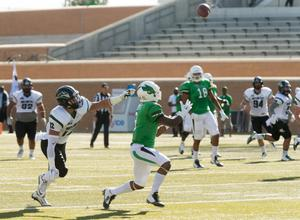 Primary view of object titled '[UNT Football Player Catching Ball]'.