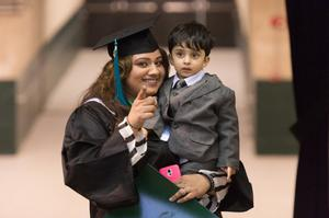 Primary view of object titled '[Graduating Student and her Son]'.