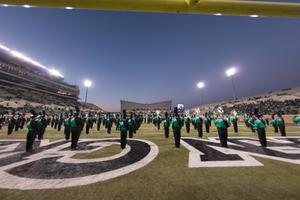 Primary view of object titled '[UNT Marching Band Performing on the Field]'.